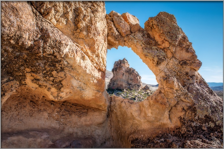 View through the natural arch along the Chimneys trail