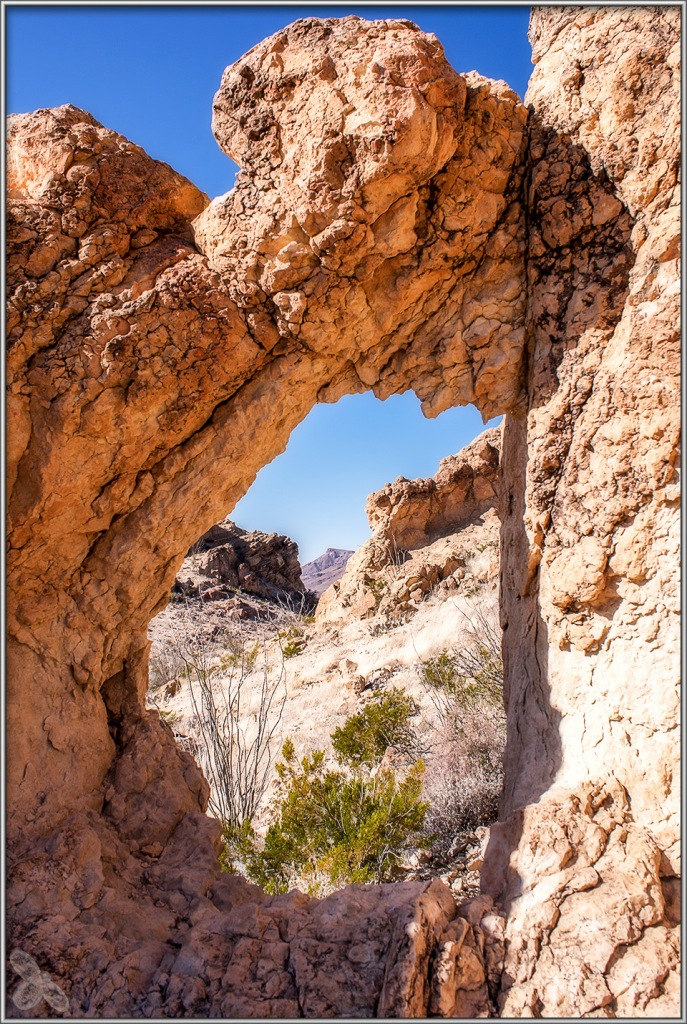 View through the other side of the natural arch along the Chimneys trail